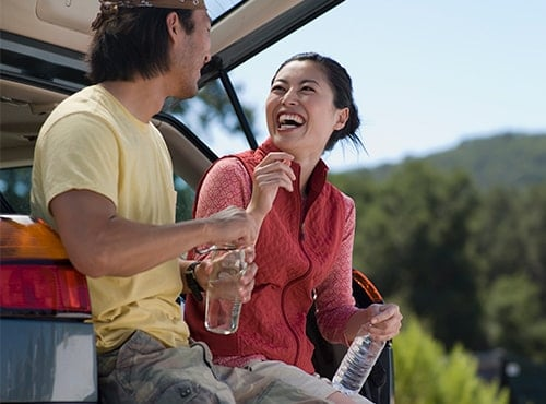 A smiling couple enjoying the outdoors illustrate how our specialty service can benefit your active lifestyle.