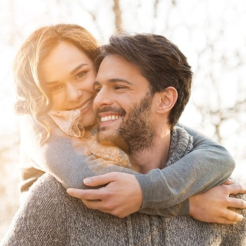 A happy couple showing they are enjoying life, which is what Denti Belli Dentistry wants for you.