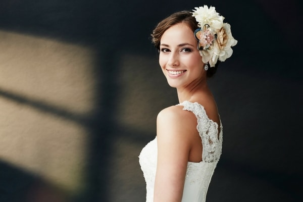 A beautiful bride smiling confidently on her wedding day because of teeth whitening in Renton, WA